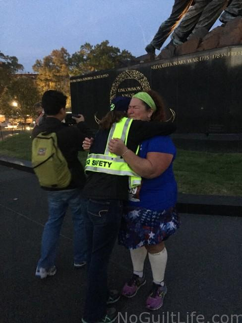 Photographer who happened upon the moment and needed to give Valerie a hug. A Marine Corps Marathon story from the back of the pack runner.