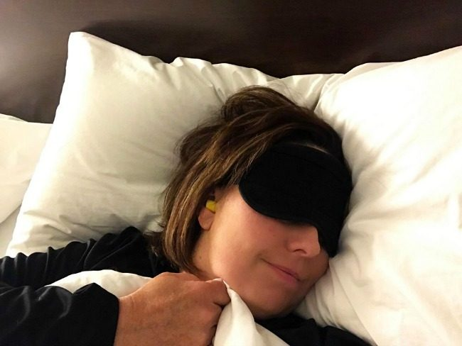 sleeping mask, earplugs in a hotel are part of my tips on how to sleep better