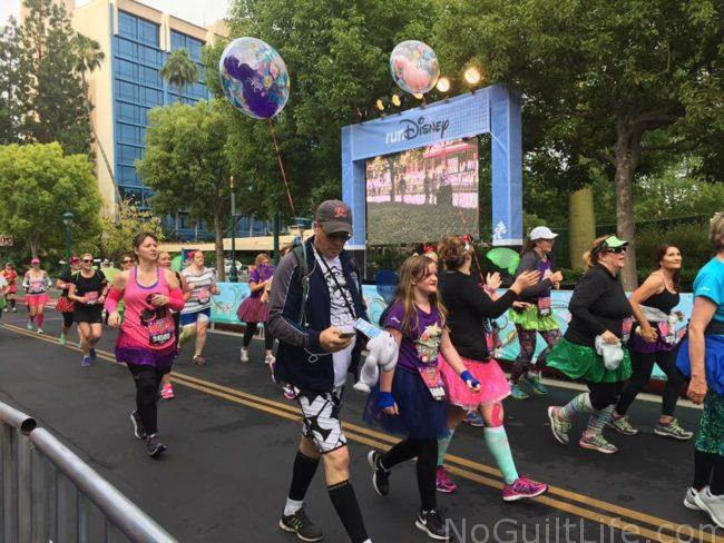 No, those balloons aren't costumes. They are part of the runDisney Balloon Lady and Balloon man equipment and signal that it's time for runners to move. That means you, Princess! Check out some tips straight from the Balloon Man of Disneyland. Tinker Bell | Disneyland Half | Avengers | Star Wars