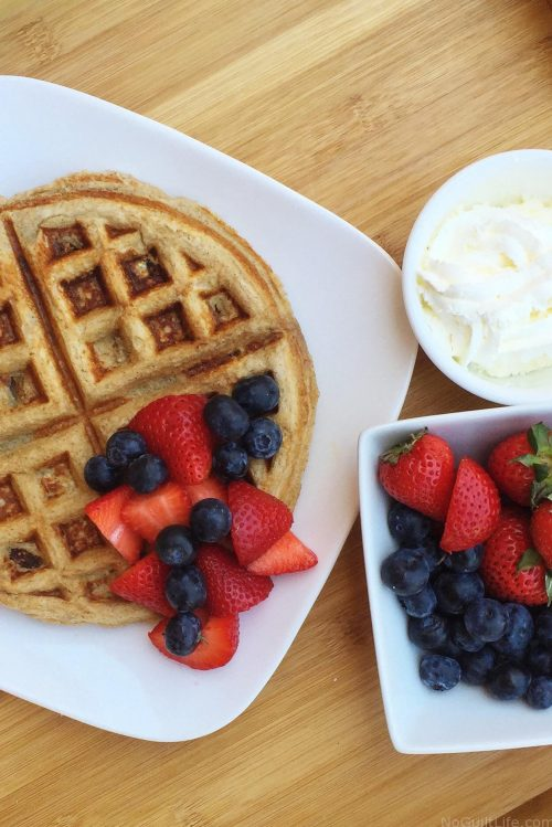 Protein waffles with berries and cream is a great way to refuel with proteins and carbs. Throw in some BCAAs and I'm on the road to my next workout. Vanilla Banana Protein Waffle recipe with Whey Protein Powder. #proteinpowder #proteinrecipe #recipe #waffles #breakfast
