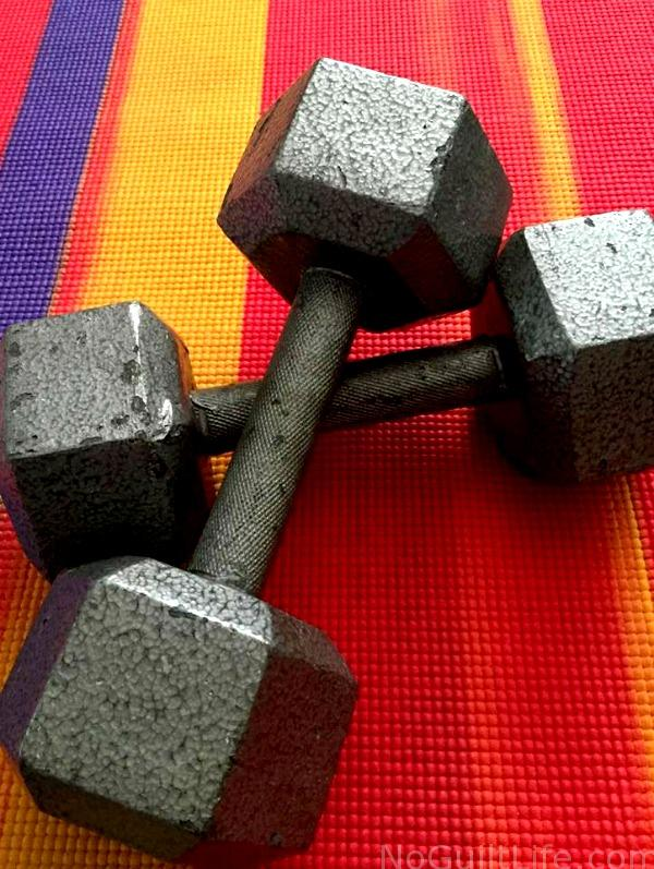 dumbells on a yoga mat