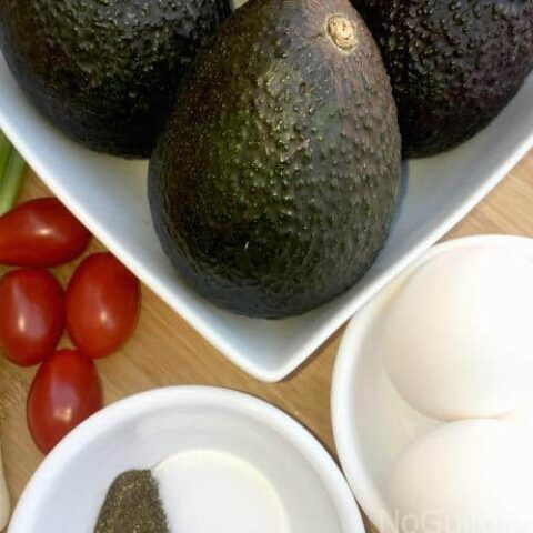 Baked eggs in Avocado: two all-star ingredients for your summer Atkins compliant meals.! Low carbs, high flavor. Gluten Free and Dairy Free. Perfect for brunch or breakfast.