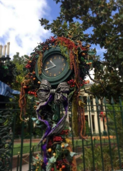Halloween decorated clock outside of the haunted mansion at Disneyland