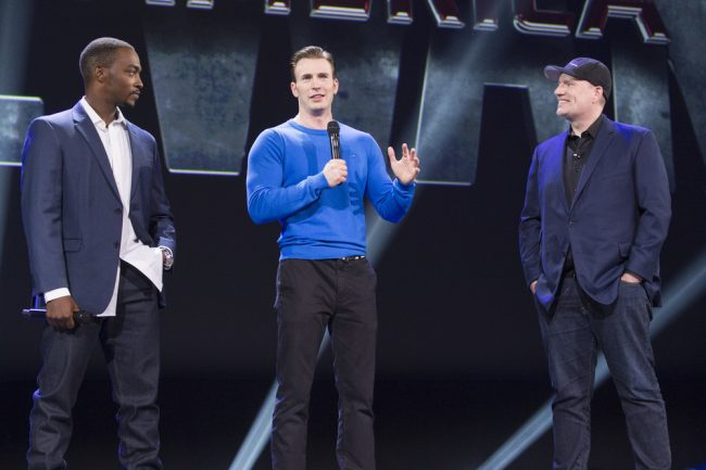 Anthony Mackie , Chris Evans blue sweater, Kevin Feige on D23 Expo stage