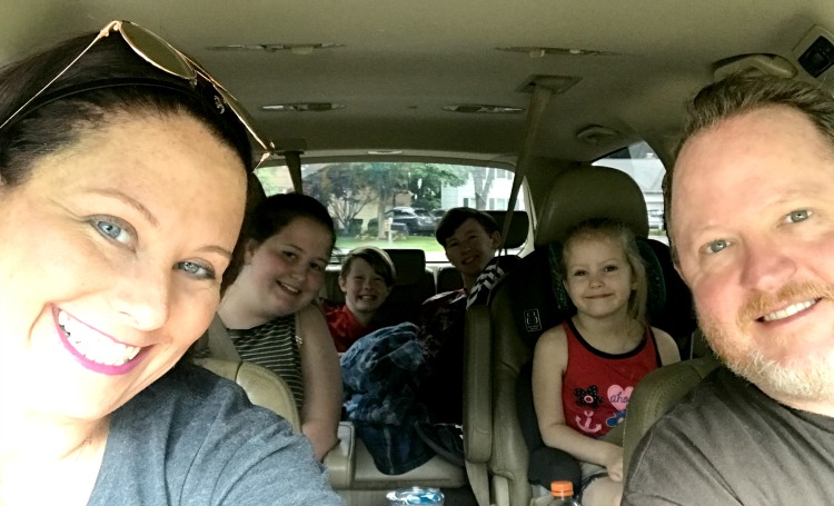 road trip family picture in car