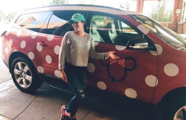 girl standing next to a Minnie Van from Lyft Orlando