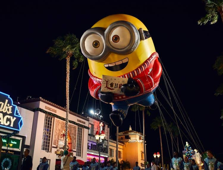 Universal studios christmas includes a minion float from macys day parade