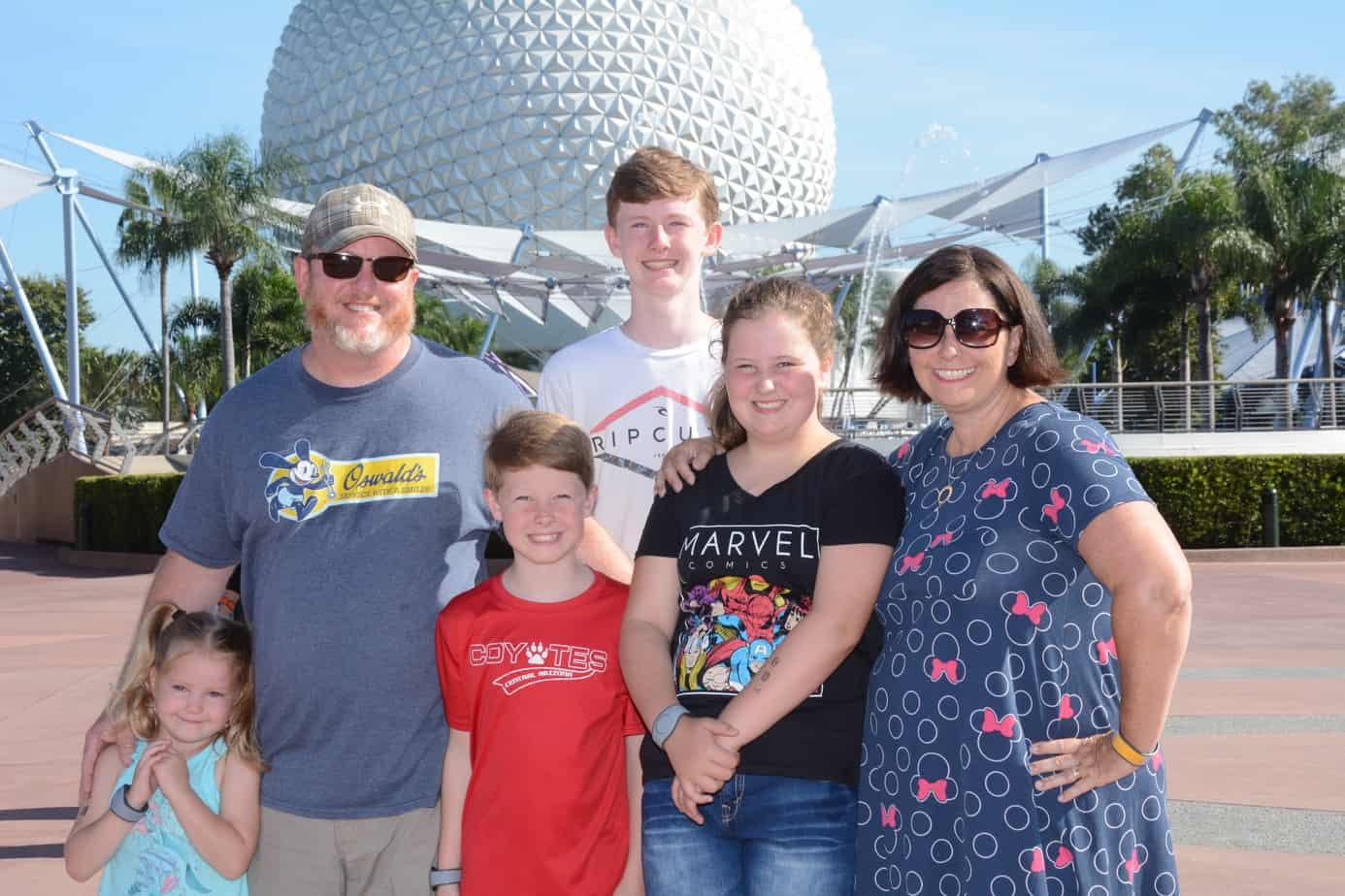 Family in front of Spaceship Earth Epcot ways to remember your disney vacation