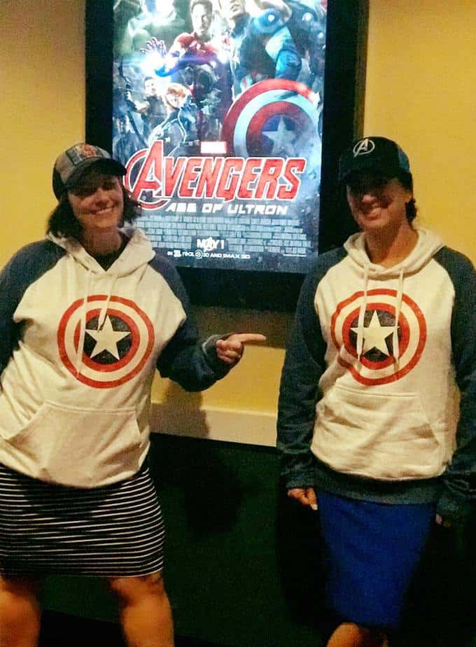Two women in Captain America sweatshirts at the movie theater