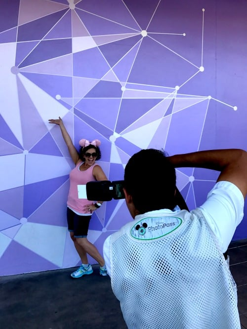 Purple Wall In Disney World PhotoPass Photographer taking the picture to remember your Disney vacation
