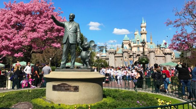 Sleeping Beauty Castle and Partners Statue in the Spring Disneyland free stuff in Disneyland