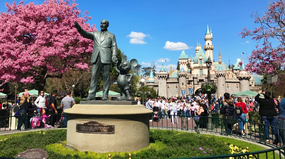 Sleeping Beauty Castle and Partners Statue in the Spring Disneyland Good Neighbor Hotels