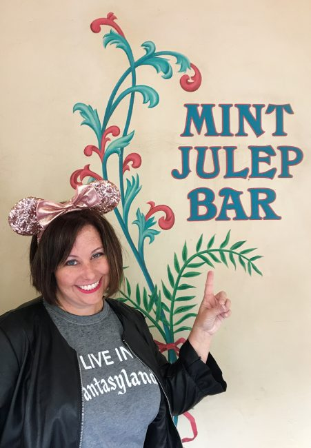 Girl in front of the Mint Julep Bar Wall in Disneyland Instagram Disney Walls