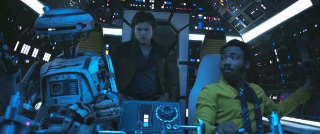 Alden Ehrenreich is Han Solo, Donal Glover is Lando Calrissian and Phoebe Waller-Bridge is L3-37 in SOLO: A STAR WARS STORY