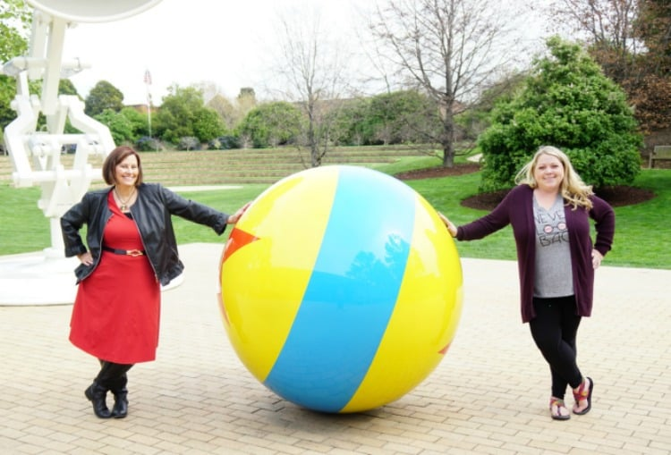 ladies in front of Luxo ball and bouncing lamp outside of Pixar studios in california