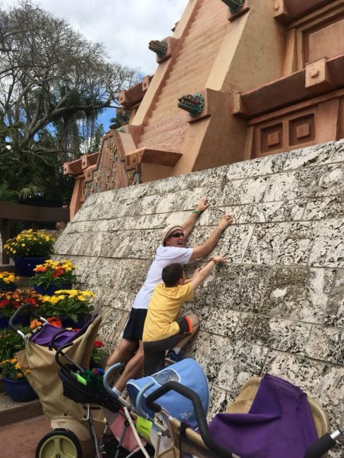 climbing the Mexico Wall in Epcot at Disney World