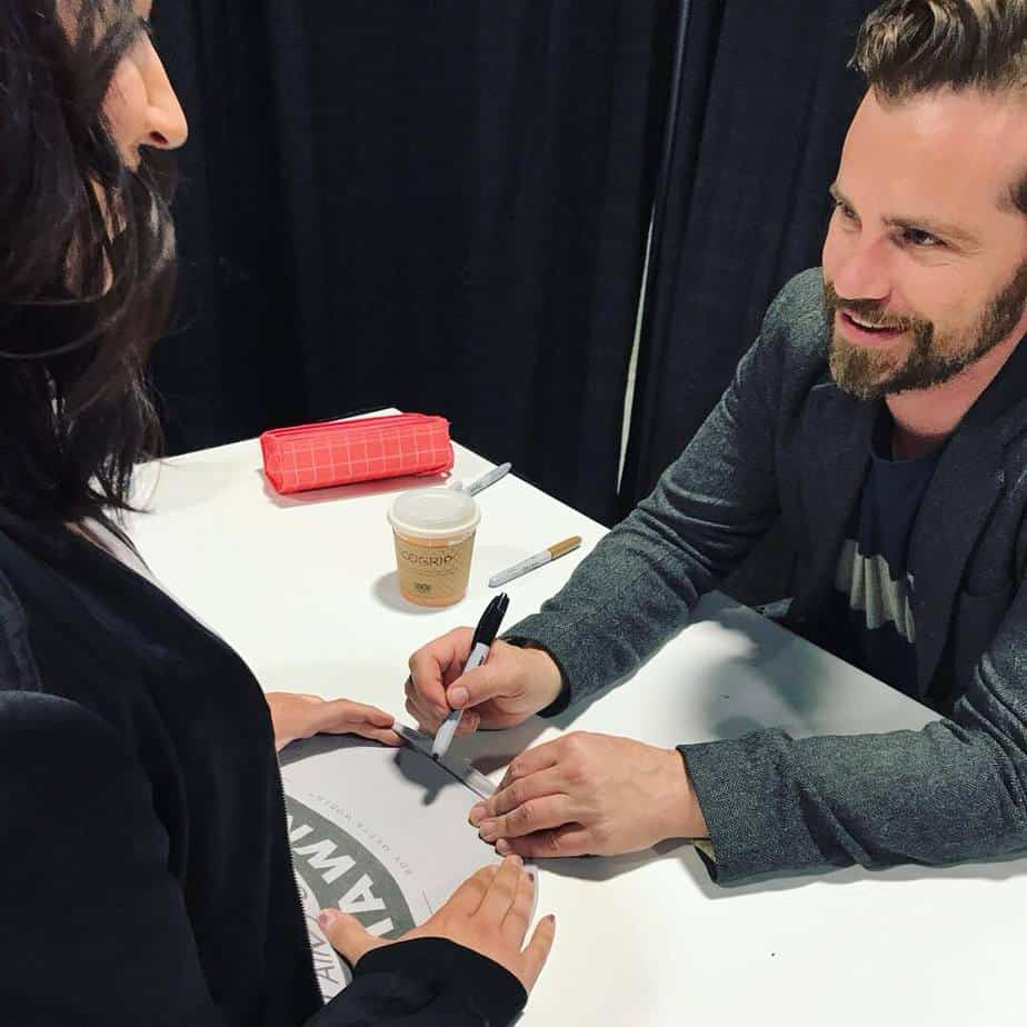 Rider Strong from Boy Meets World and fan at Awesome Con autograph session