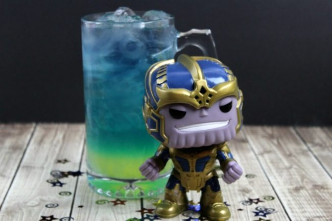 Thanos Avengers Marvel cocktail layered drink with Thanos Pop Funko
