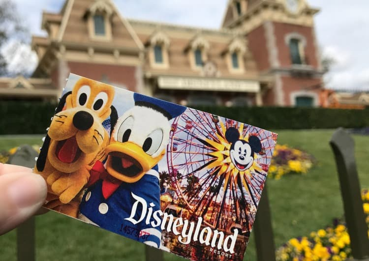 Disneyland ticket in front of train station
