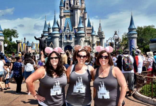 girls wearing Mickey ears headbands in front of the castle at Disney World