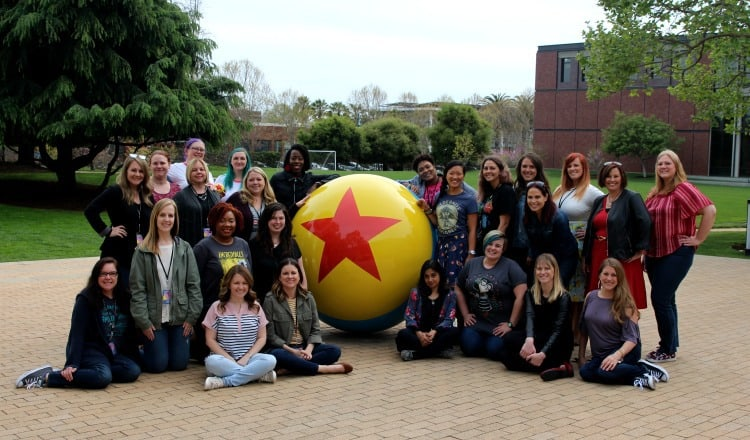 pixar incredibles event group picture in front of the Pixar Studios ball