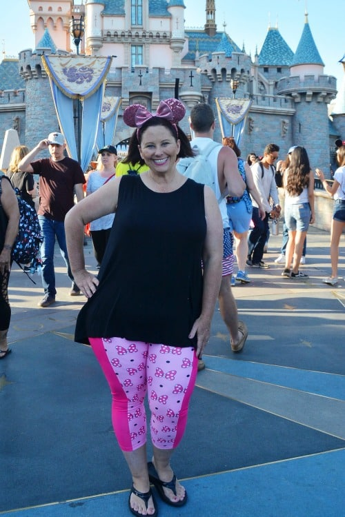 Wish Cricket Minnie Mouse Capris in front of Disneyland castle