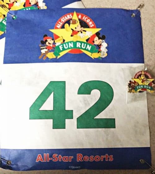 The All-Stars and Icons fun run bib and pin swag at Disney World