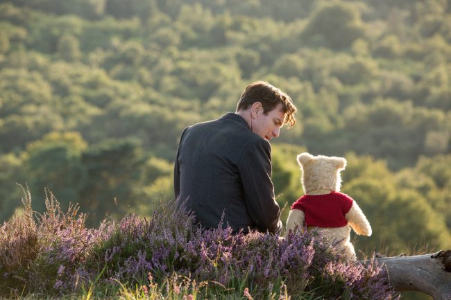 Christopher Robin. (Ewan McGregor) with his long time friend Winnie the Pooh in Disney?s live-action adventure Christopher Robin