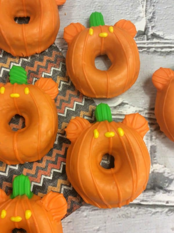 Mickey shaped orange pumpkin donuts