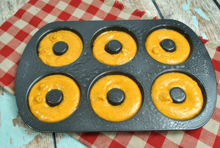 pumpkin spice donut batter poured into donut pan