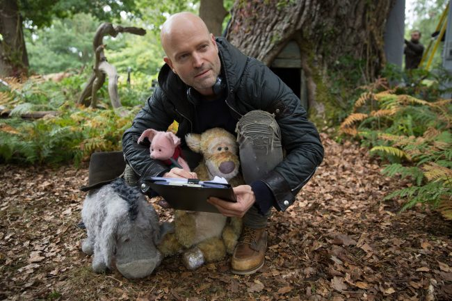 Marc Forster with Eeyore, Piglet and Tigger on the set of Disney's CHRISTOPHER ROBIN.