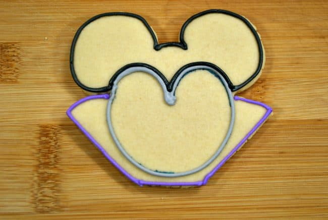 Vampire Mickey Mouse cookies in process.