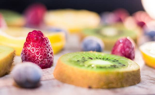 Image of fruit on a plate kiwi and berries