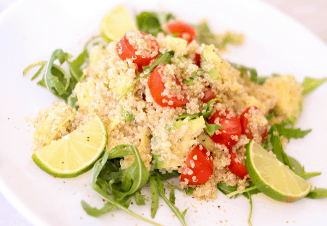 quinoa and vegetables on a white dish