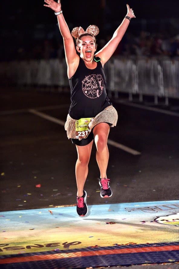 running across the finish line at rundisney race weekends