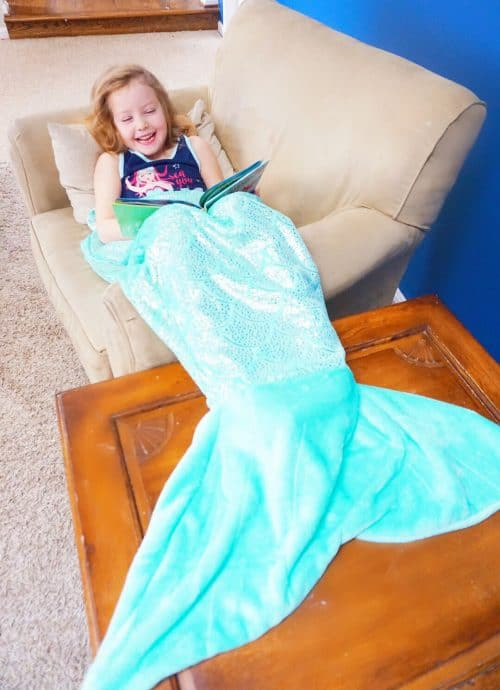 Blonde girl in a Mermaid Tail blanket