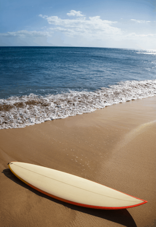 surf board on the beach in Hawaii