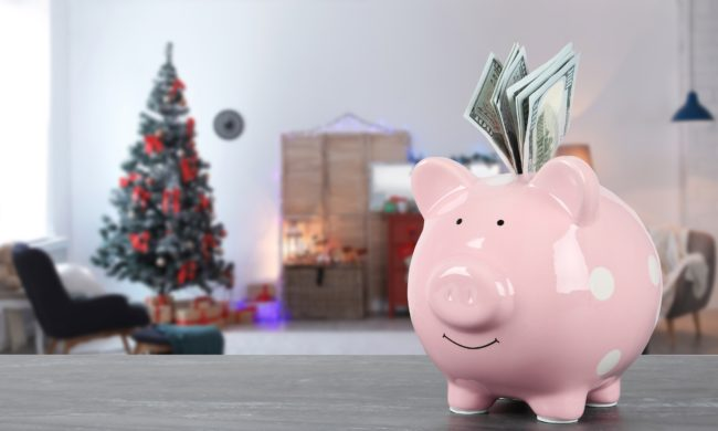 Christmas in July: put money in the piggy bank now Christmas tree in background