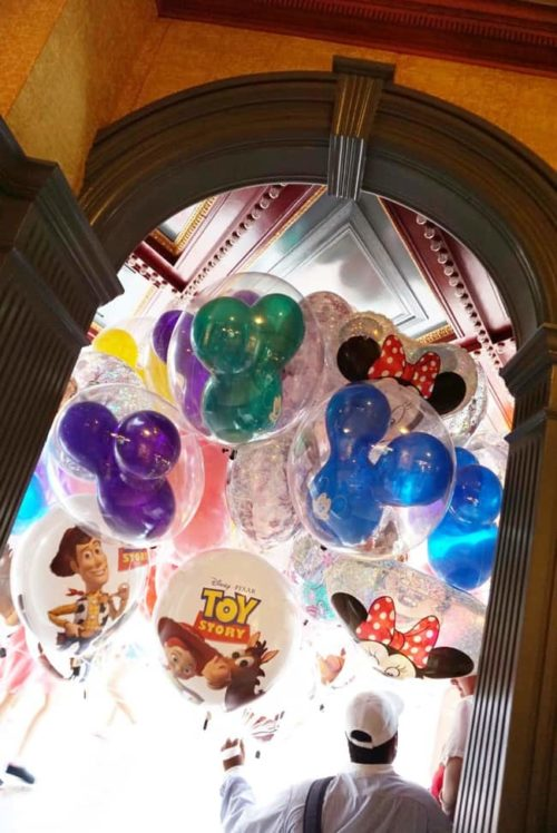 Disney Balloons under the cover during a rain storm at Disney World