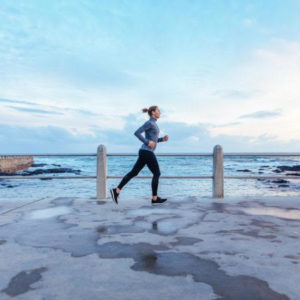how to start running when you are a complete beginner woman running in front of ocean