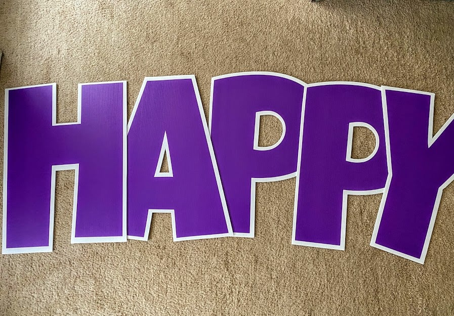 purple happy birthday yard sign